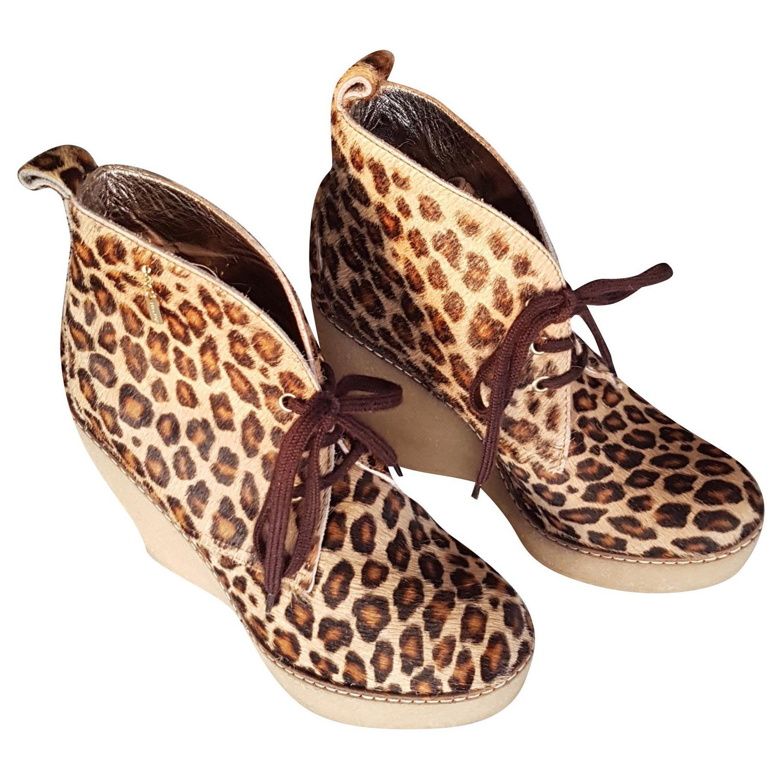 Boots Serafini talons compensés.