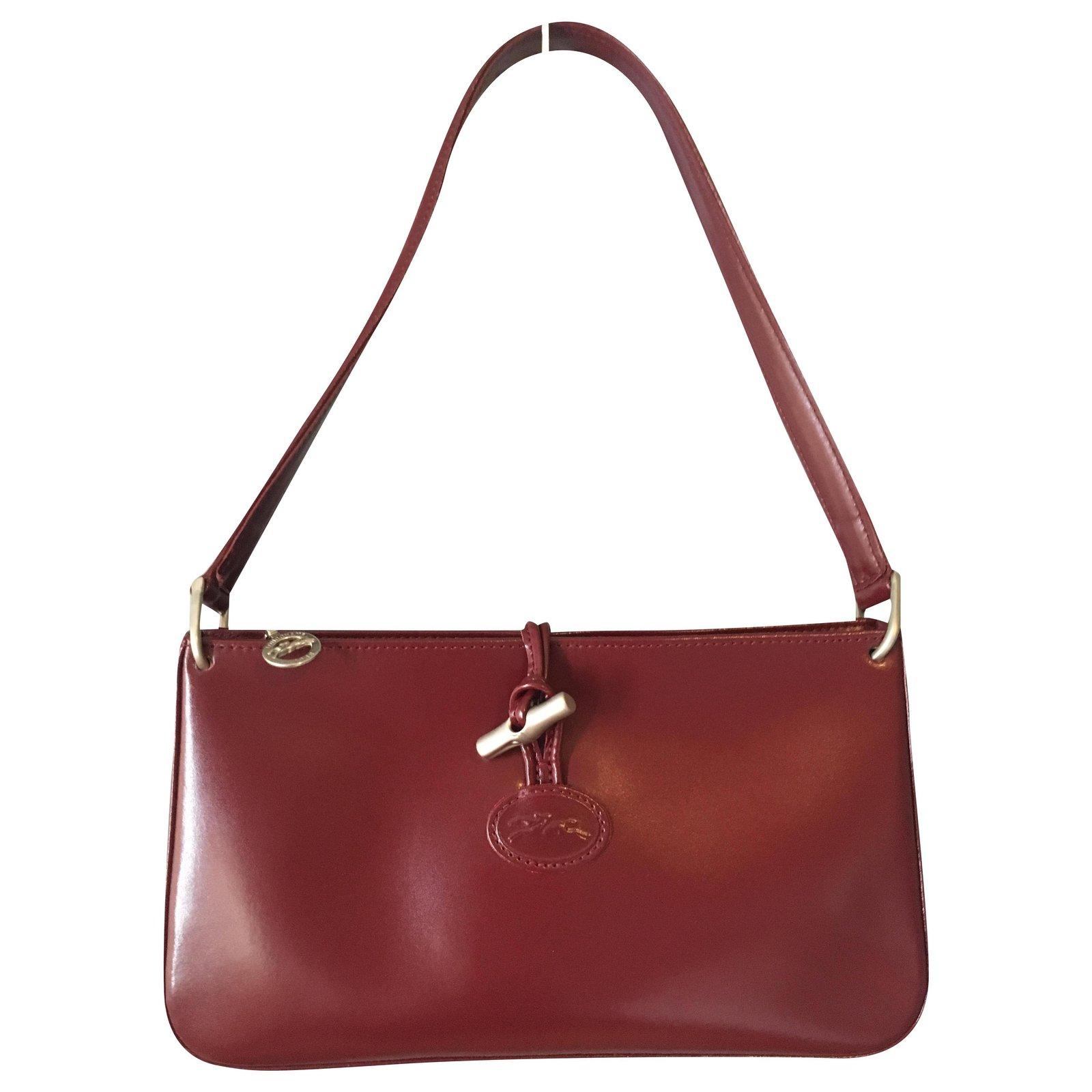 Sac Longchamp vintage, modèle Roseau, en cuir de vachette dans les tons  fuchsia foncé / bordeaux
